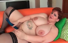 Mature BBW plays with her dildo