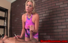 Smoking blonde masseuse strokes black client