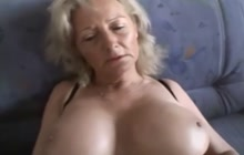 Naughty Kathy Klyne masturbates on the couch