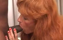 Redhead mature fucks black dick
