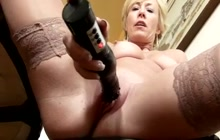 Sexy mature woman masturbates with sex toy