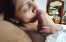 Indian mature woman sucking on cock