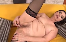 Pretty Barbarella works her pussy with vibrator