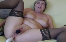 Hot lady in stockings plays with toys